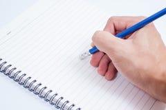 Hand mit Bleistiftschreiben etwas auf weißem Hintergrund Stockbilder