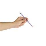 Hand mit Bleistiftschreiben etwas lokalisiert auf weißem Hintergrund Stockbild
