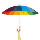 Hand mit buntem Regenschirm Stockfotos