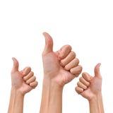 Hand mit dem Daumen oben auf weißem Hintergrund Stockfotografie