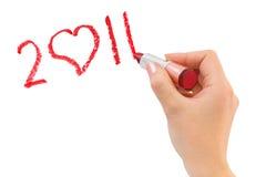 Hand mit dem Lippenstift, der 2011 zeichnet Lizenzfreies Stockbild