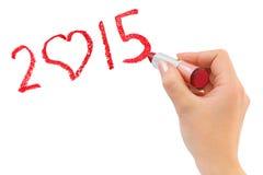 Hand mit dem Lippenstift, der 2015 zeichnet Lizenzfreies Stockbild