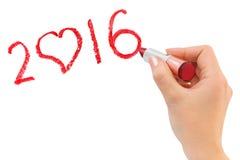 Hand mit dem Lippenstift, der 2016 zeichnet Lizenzfreie Stockbilder