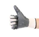 Hand mit dem weißen Gewebehandschuh, der sich Daumen zeigt stockfotografie