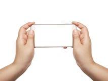 Hand mit dem weißen Schirm des intelligenten Telefons lokalisiert Lizenzfreies Stockfoto