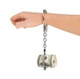 Hand mit den Handschellen und Geld Lizenzfreies Stockfoto