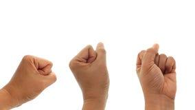 Hand mit der Faust, die das Kommunismussymbol lokalisiert auf Weiß macht Stockfoto