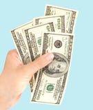 Hand mit Dollar Stockbild