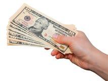 Hand mit Dollaranmerkungen Stockbild