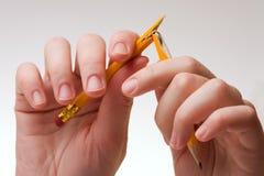 Hand mit einem Bleistift Stockfotos