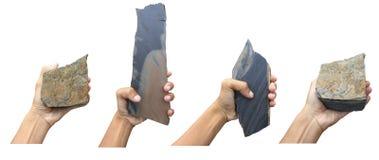 Hand mit einem Felsen getrennt auf einem weißen Hintergrund Lizenzfreie Stockbilder