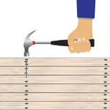 Hand mit einem Hammer Lizenzfreie Stockfotos