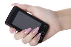 Hand mit einem Handy Stockbilder