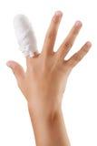Hand mit einem verbundenen Fingerverband Lizenzfreie Stockbilder