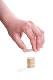 Hand mit einer Euromünze Stockbilder