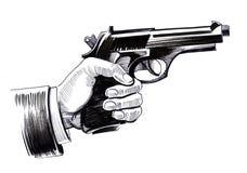 Hand mit einer Gewehr Stockfotos