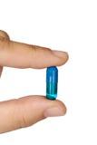 Hand mit einer Pille Lizenzfreie Stockbilder