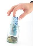Hand mit Euro Stockbild