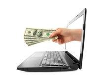 Hand mit Geld und Notizbuch Stockfotografie