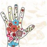 Hand mit gemalten Blumen vektor abbildung
