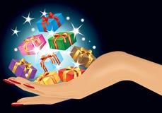 Hand mit Geschenk Stockfotografie