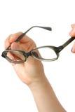 Hand mit Gläsern Stockfoto