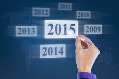 Hand mit Griffel wählt Nr. 2015 vor Lizenzfreie Stockfotos