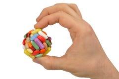 Hand mit großer Pille Stockfotografie