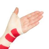 Hand mit Handgelenk- und Daumenschiene Stockfoto