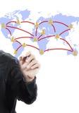 Hand mit Handlungsfreiheitzeichnung der Weltkarte Stockfotos