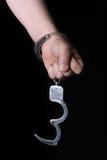 Hand mit Handschellen Stockfotografie