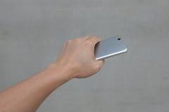 Hand mit Handy Stockbilder
