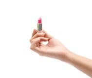 Hand mit Lippenstift Stockfoto