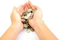 Hand mit Münzen Lizenzfreies Stockfoto