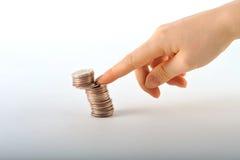 Hand mit Münzen Stockfotografie