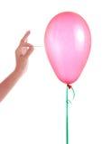 Hand mit Nadel und Ballon stockfoto