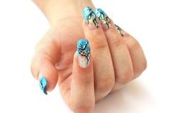 Hand mit Nagelkunst Stockfotografie