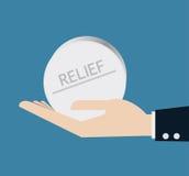 Hand mit Pille der Entlastung Lizenzfreie Stockfotos