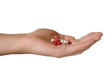 Hand mit Pillen Lizenzfreie Stockbilder