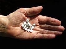 Hand mit Pillen Stockbilder