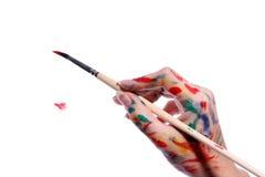 Hand mit Pinsel Lizenzfreie Stockfotografie