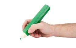 Hand mit riesigem Bleistift Stockfotos