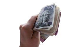 Hand mit schottischer geld- Bestechung, Lohnbargeld, Geld gebend, Korruptionskonzept Stockbild