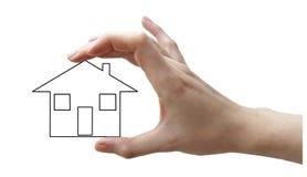 Hand mit schwarzem Konzepthaus Lizenzfreies Stockfoto