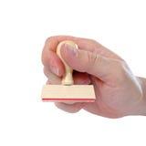Hand mit Stempel Stockbild
