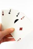 Hand mit vier Assen Königliche Spaten des Spielkartekasinoblinkens Stockbilder