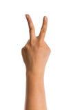 Hand mit zwei Fingern oben Stockbild