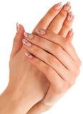 Hand mit zwei Frauen mit Nagelkunst Lizenzfreies Stockbild