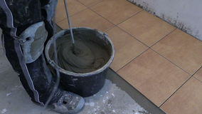 Hand mix tile cement with machine tool at kitchen stock video