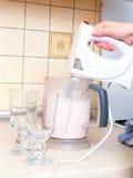 Hand with mixer making milkshake Royalty Free Stock Photo